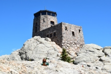 Lamar sitting in front of the lookout tower, Black Elk Peak